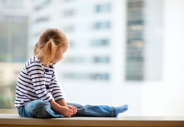 bigstock-Adorable-little-girl-sitting-b-32435780